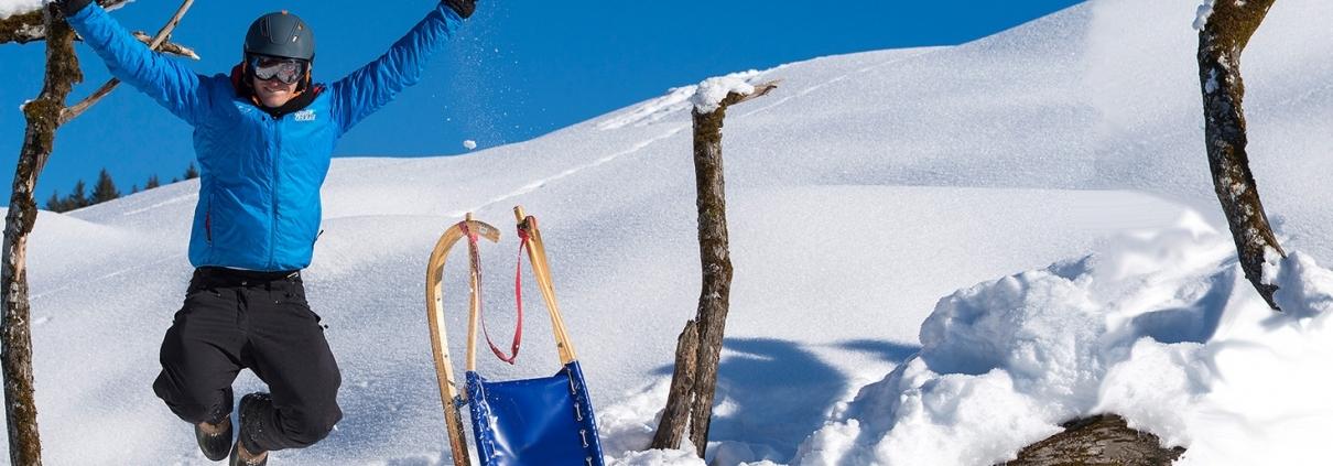Rodler im Schnee am Hocheck in Oberaudorf